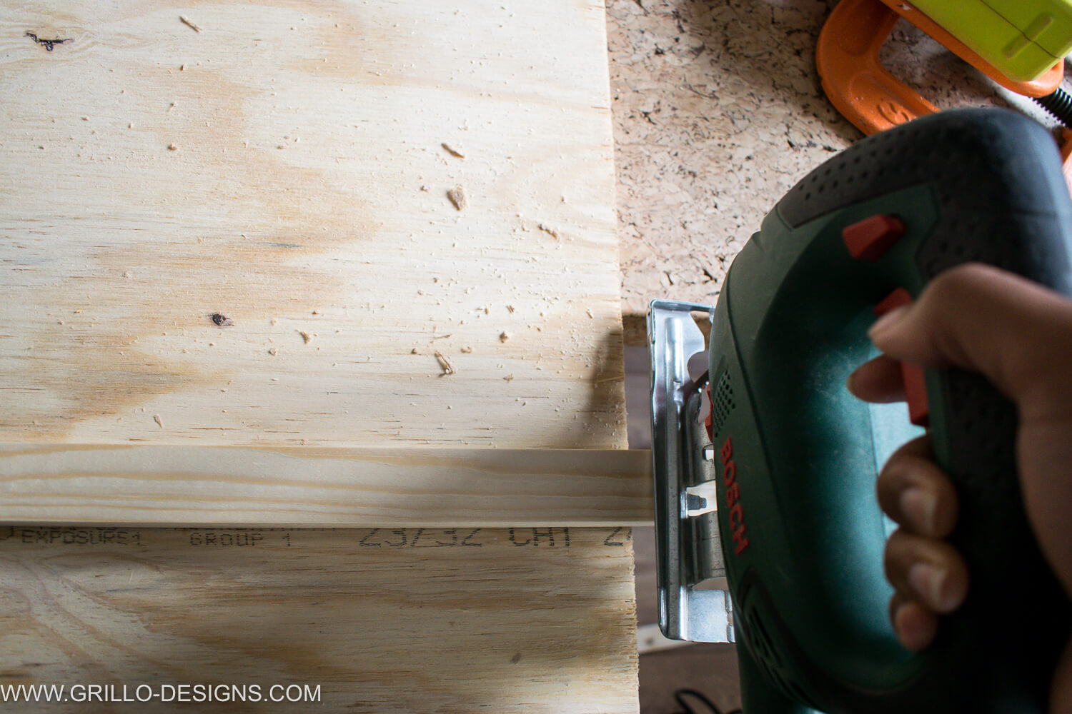 Use a jigsaw to cut softwood for zeroes and cross the board boundary