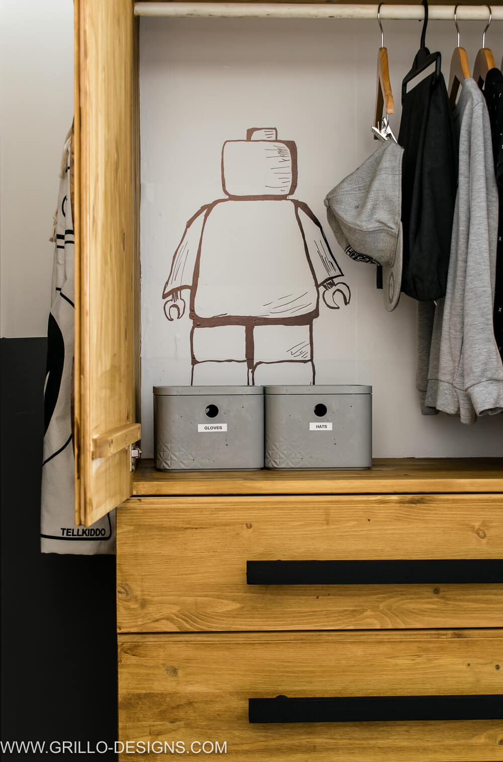 Closer look into the inside of the wardrobe. A hand drawn lego figure is seen to the left of the wardrobe