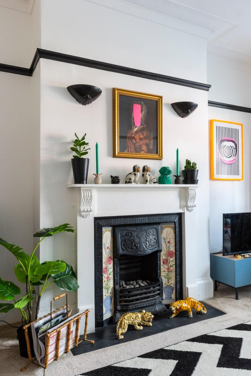 view of fireplace just below a picture rail