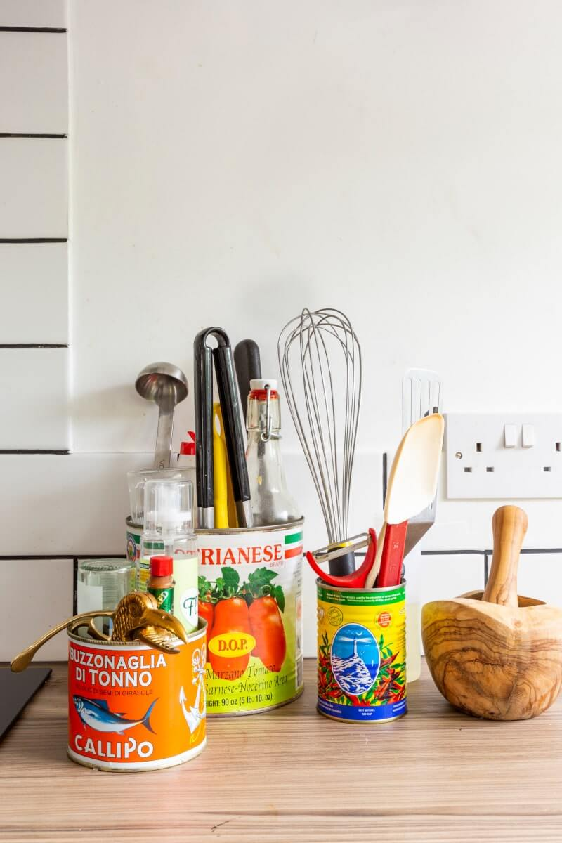 Upcycled tins used as utensil holders
