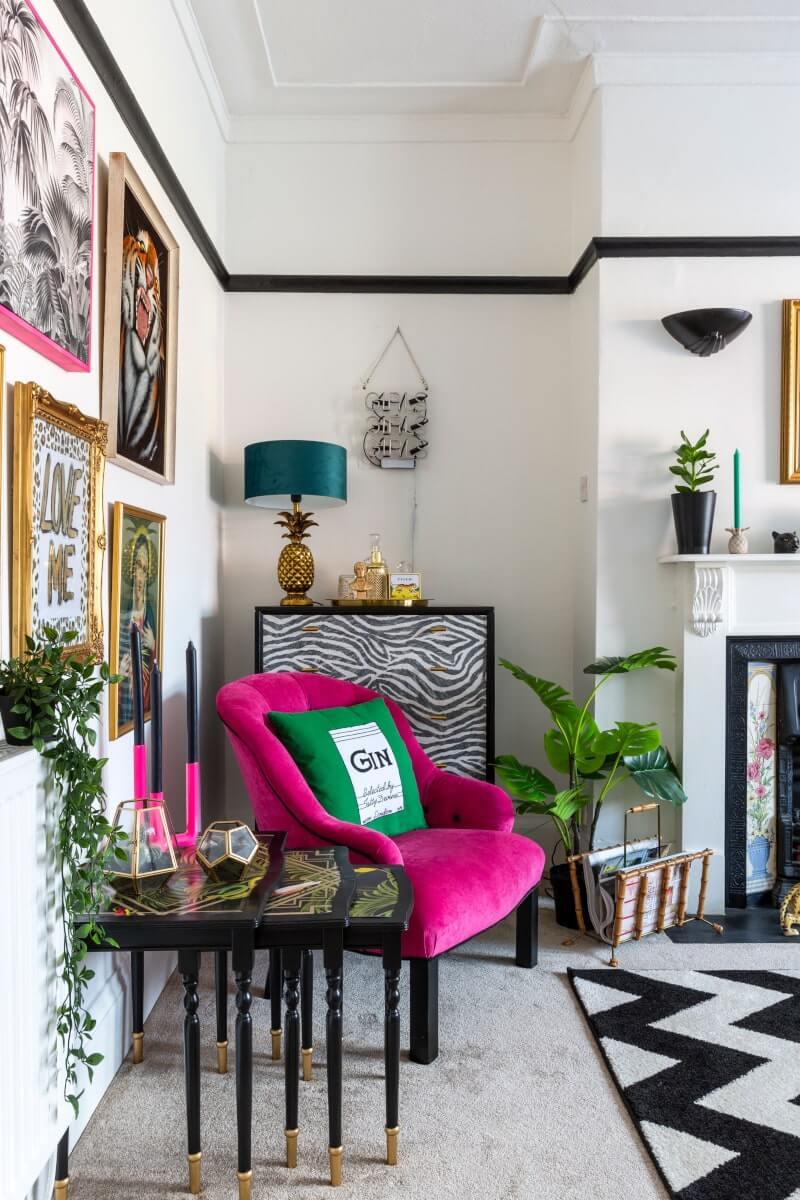 Shot of living room interior from the doorway - featuring velvet sofa