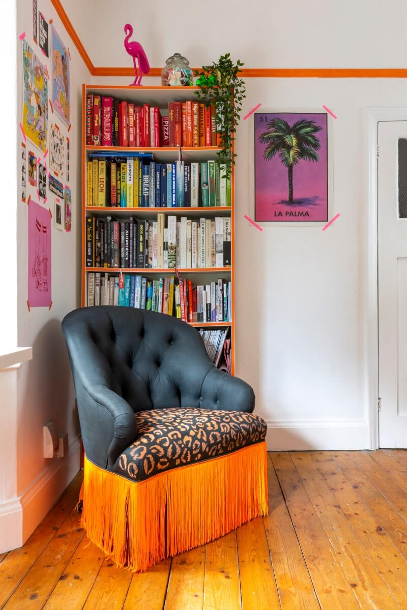Bookcase filled with books organised by colour