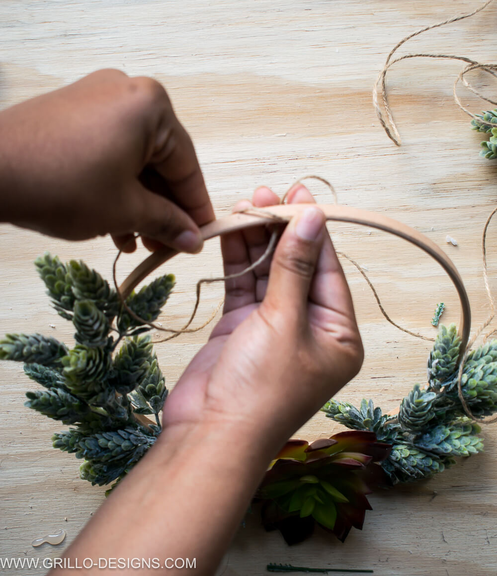 Looping the jute string to the top of the succulent wreath