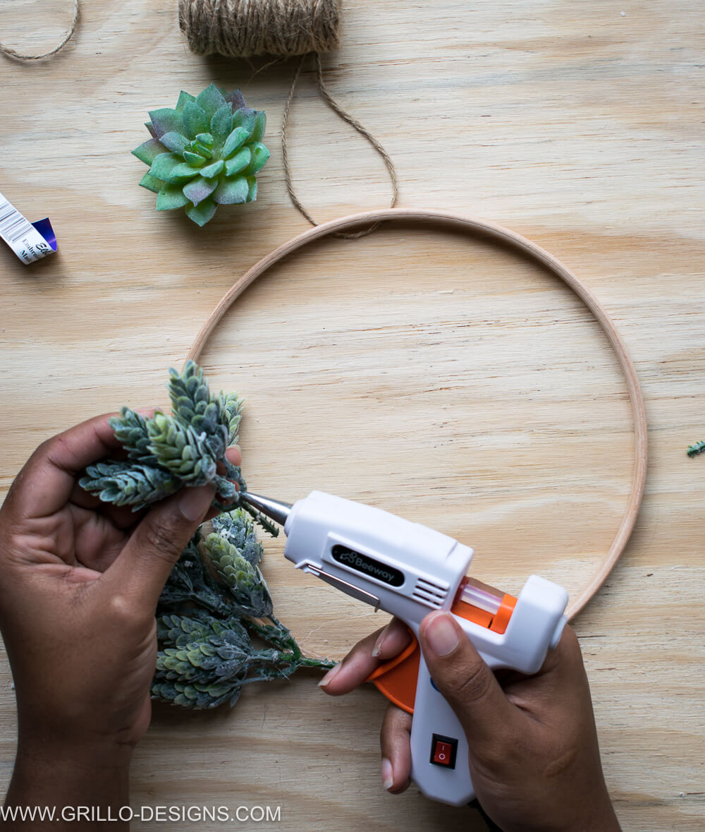 Use glue gun to stick the succulent leaves to the wreath