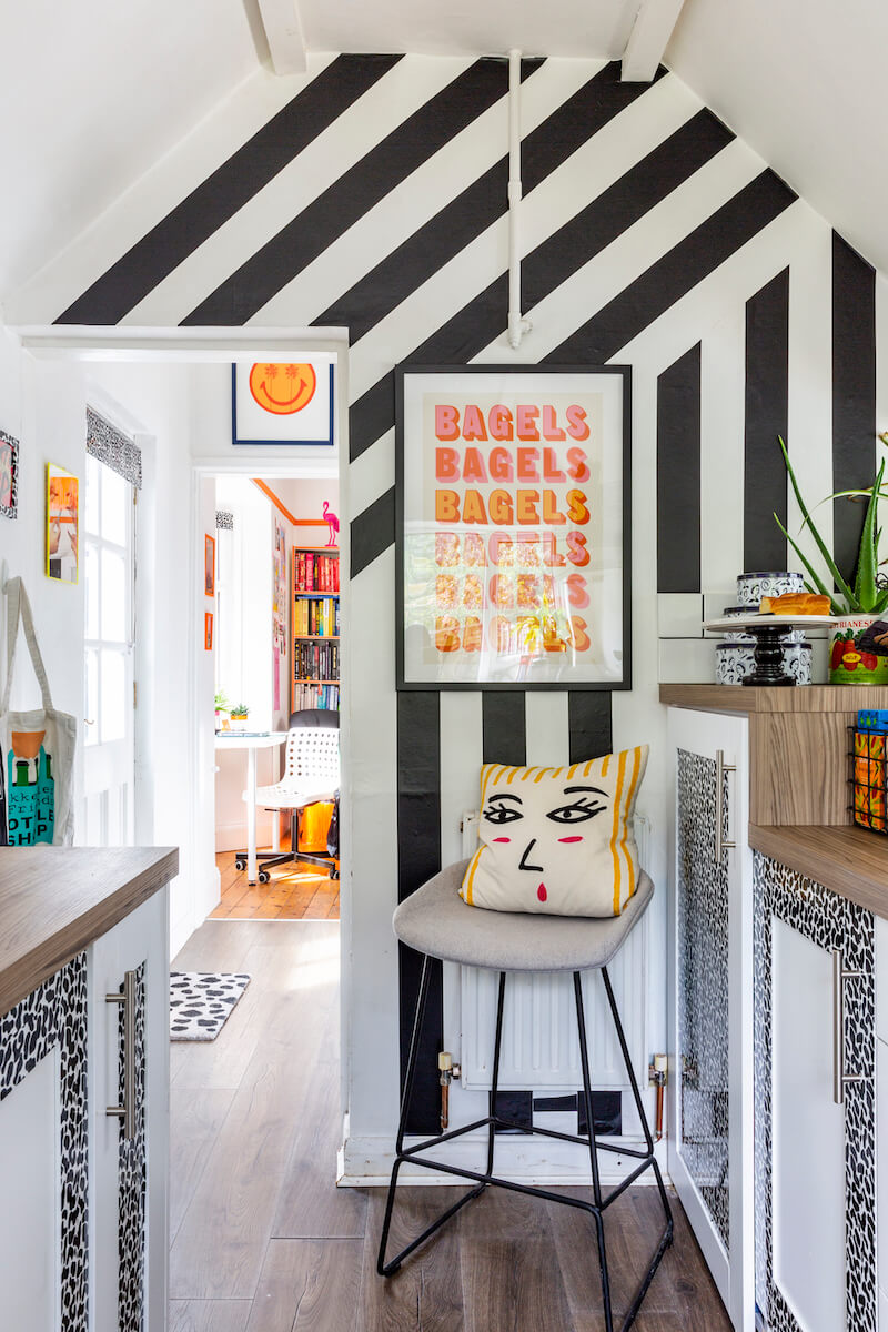 Monochrome black and white wall in the kitchen decorated with contact paper