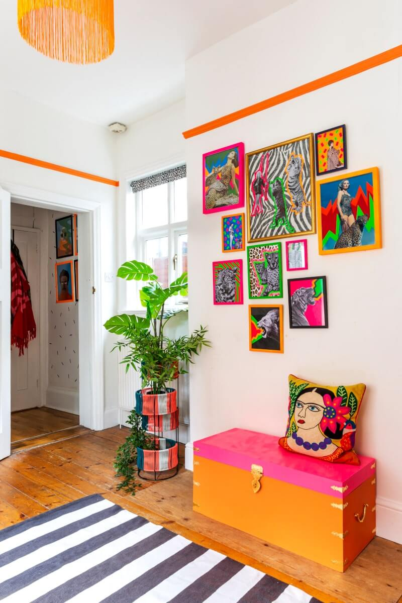 Gallery wall with neon frame and art