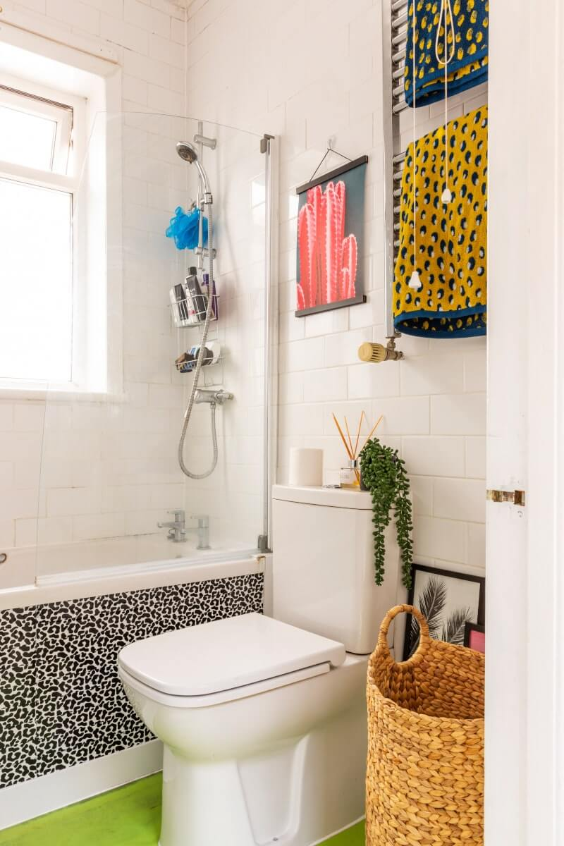 View of rented bathroom with leopard print colourful towels