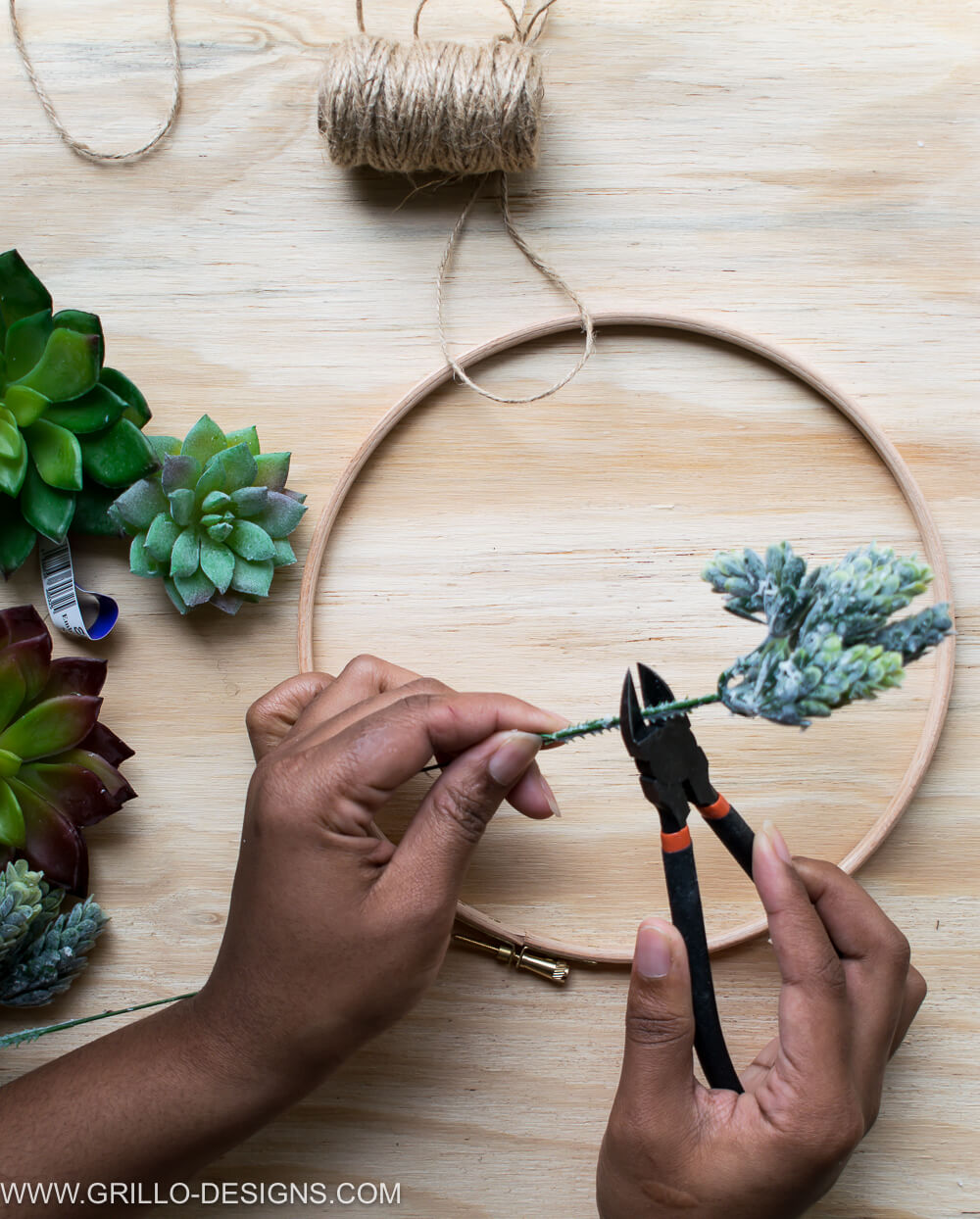 Using the cutters to cut the succulent ends