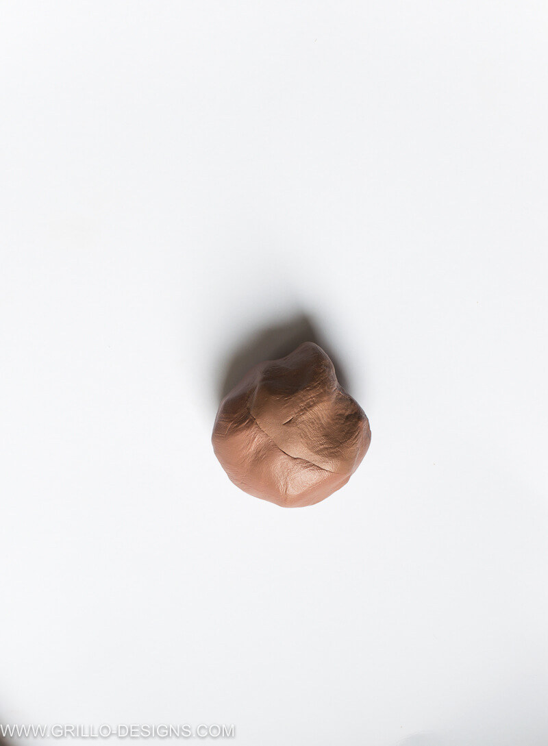 Image of nut fimo clay rolled into a ball