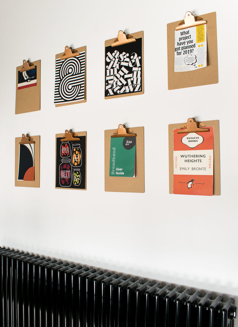 side view of clip board gallery wall above the radiator