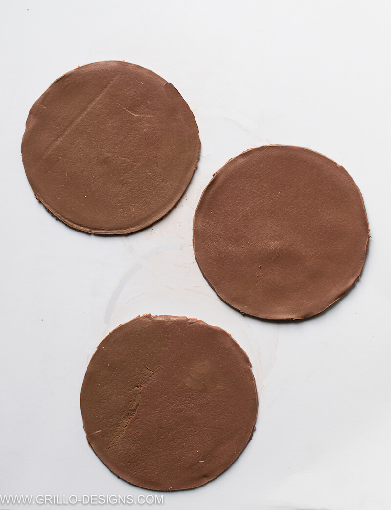 3 circles cut from the leather effect nut clay