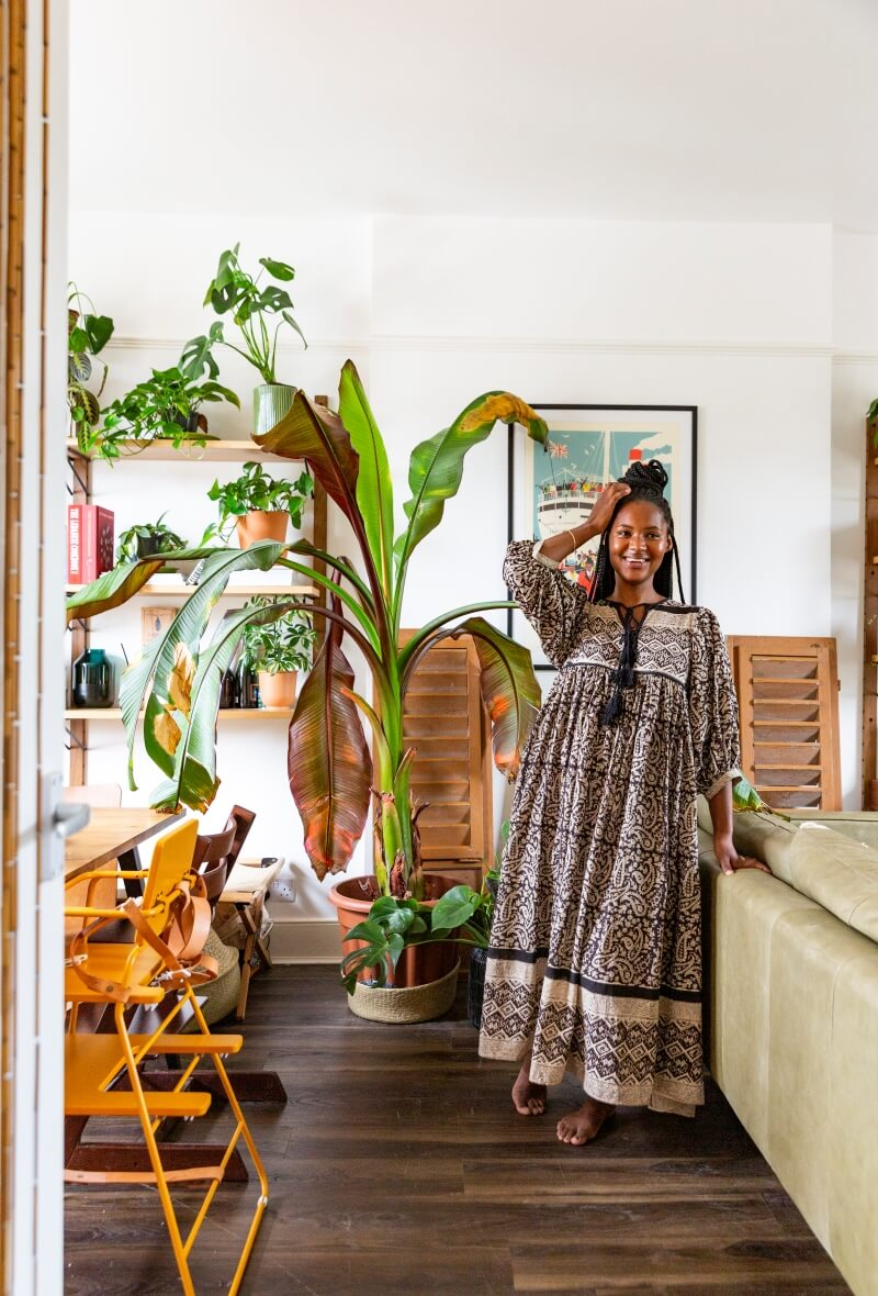 Africa daley-clarke standing in the entrance of  her living room and smiling