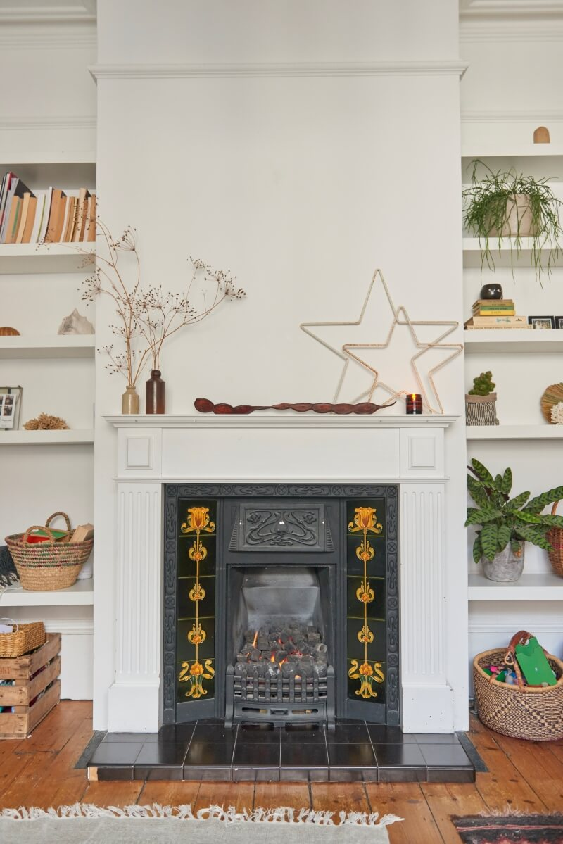 Fireplace in the living room with alcove shelving to both sides