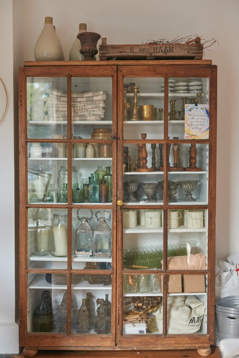 Antique glass cabinet with styling products