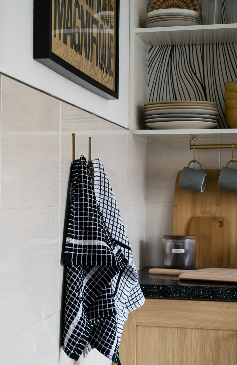 tea towels hanging with self adhesive strips on tiles