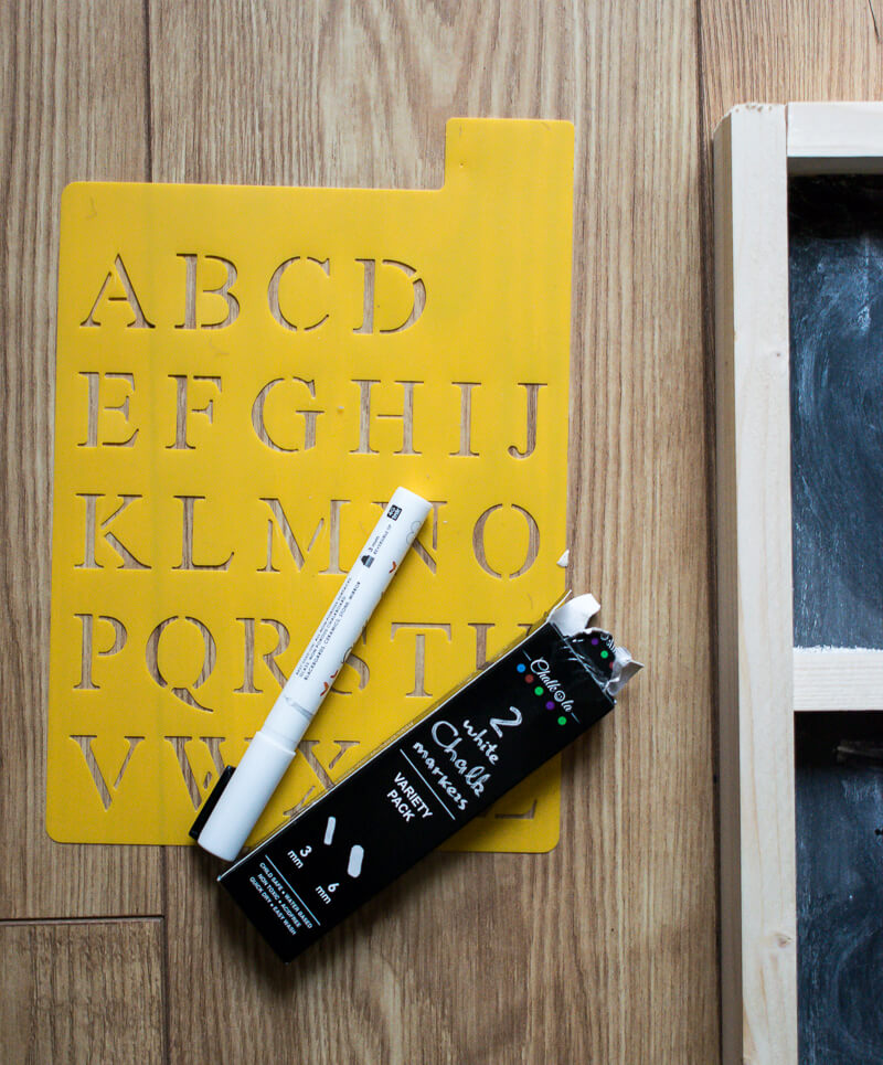 Image of yellow stencil and chalk pens
