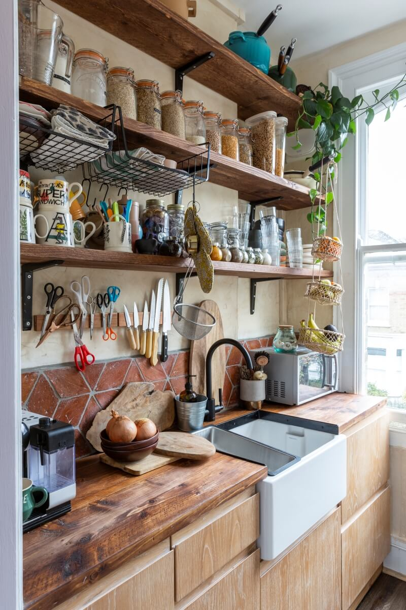 Image of social housing kitchen with open plan shelving made from wood