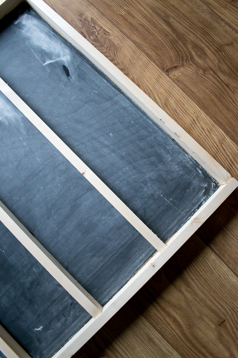 Corner of the chalkboard menu with wooden slats in place