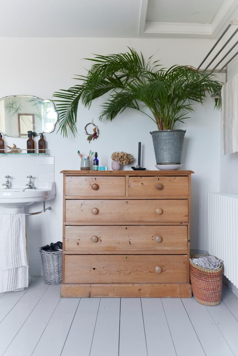 Chest of drawers in bathroom space next to sink