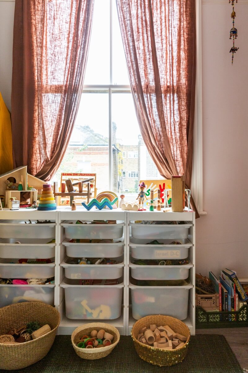 Kids storage drawers placed under the large window