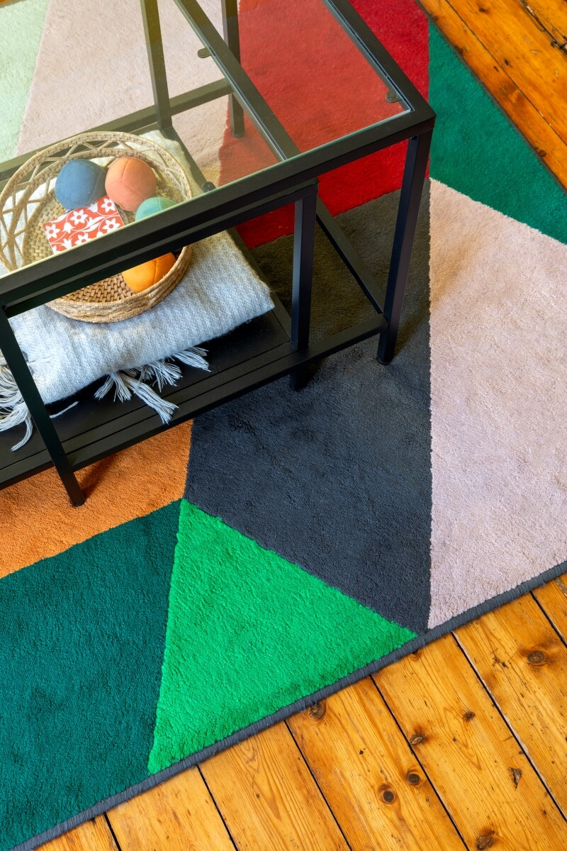 Colourful geometric rug bird eyes view in the flat share
