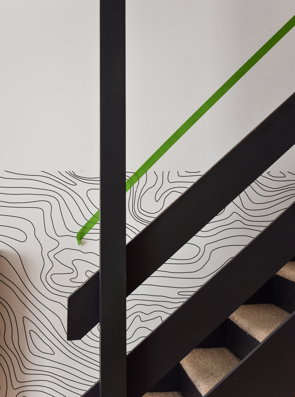 Painters tape used as a template along the staircase wall