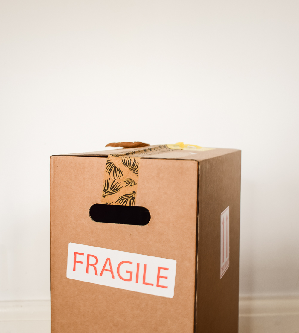 Cardboard box with fragile label on it