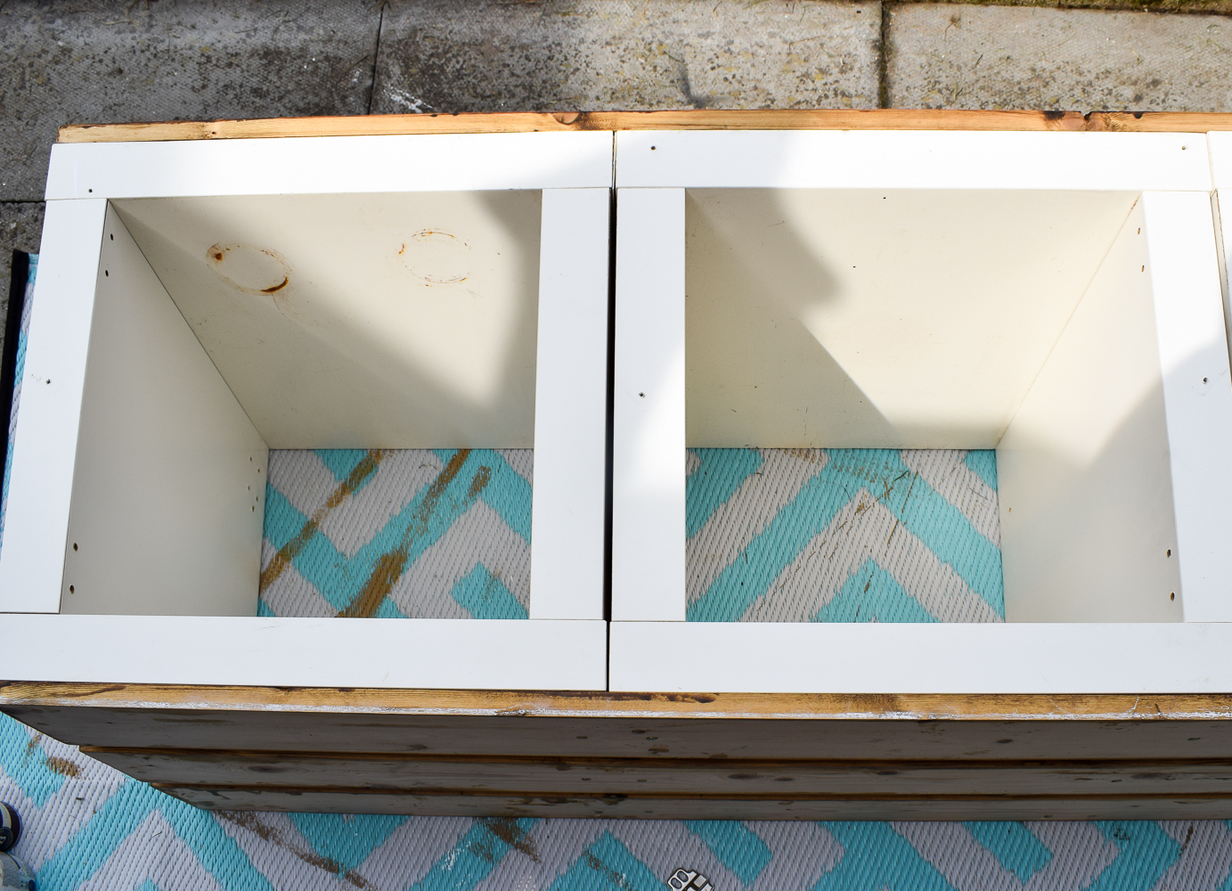 wooden planks applied to bottom and top of the ikea kallax units