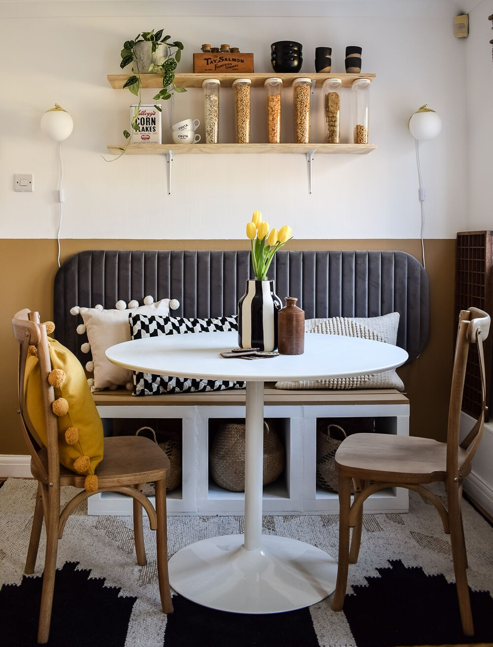 CAFE style dining nook with ikea kallax units as seating and bistro table