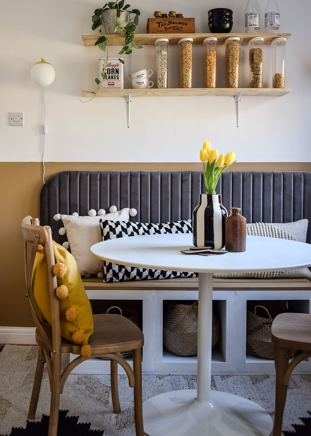 Dining breakfast book with bistro style table and grey velvet headboard