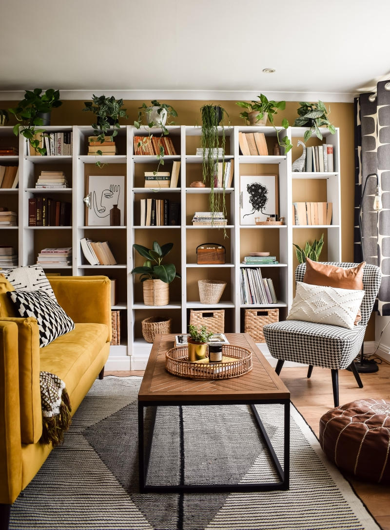 View of the eden sofa next to the wall to wall bookcase shelves