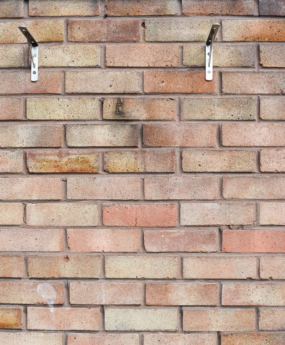 heavy duty brackets secured into brick wall