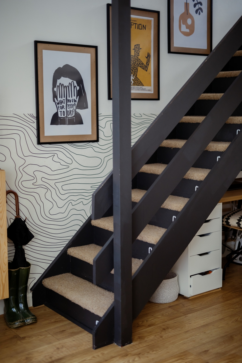 industrial painted stair riser in living room