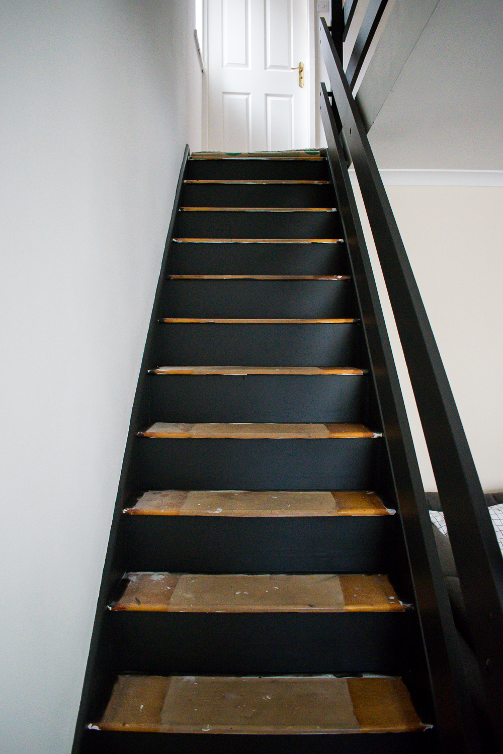 Painted risers in black with wooden treads