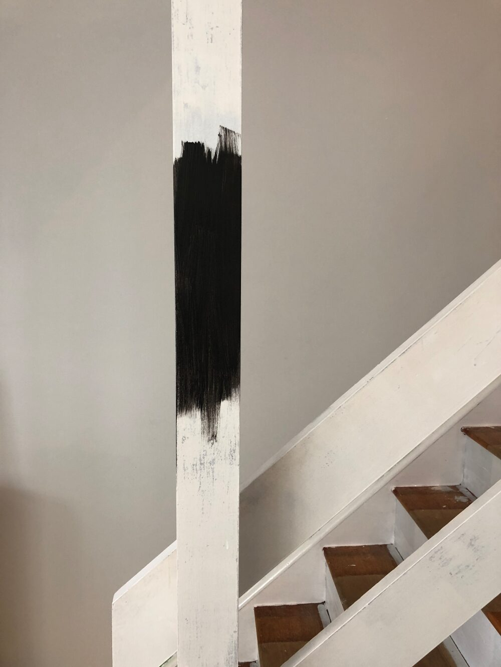 White primer on stairs and banister