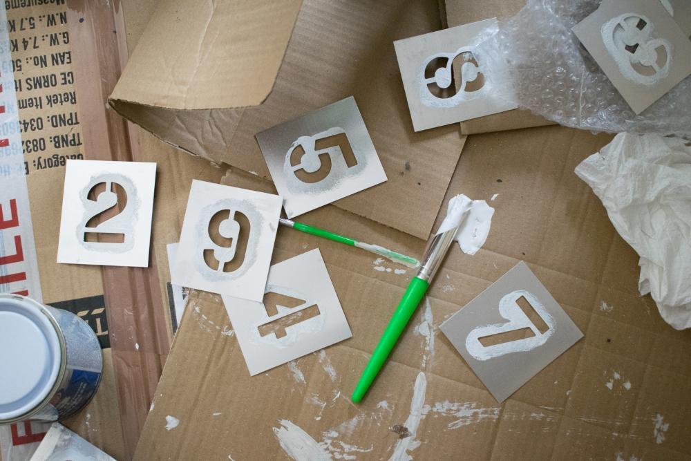 Number stencils on cardboard