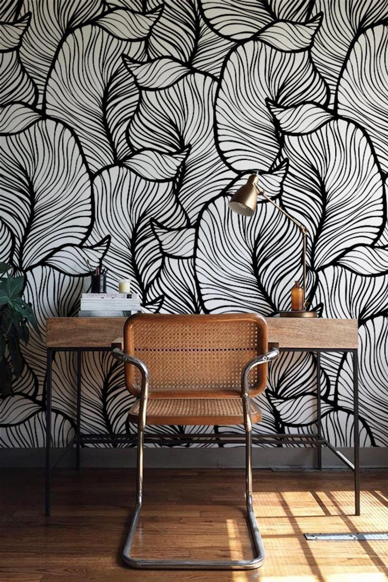 office view leaf monochrome self-adhesive wallpaper with mid century modern furniture and brass table lamp