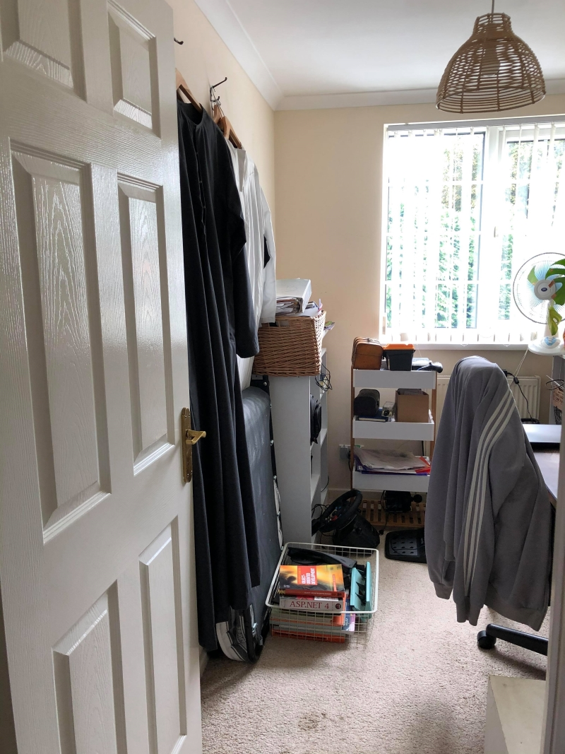 Before shot messy spare room with neutral wall colour