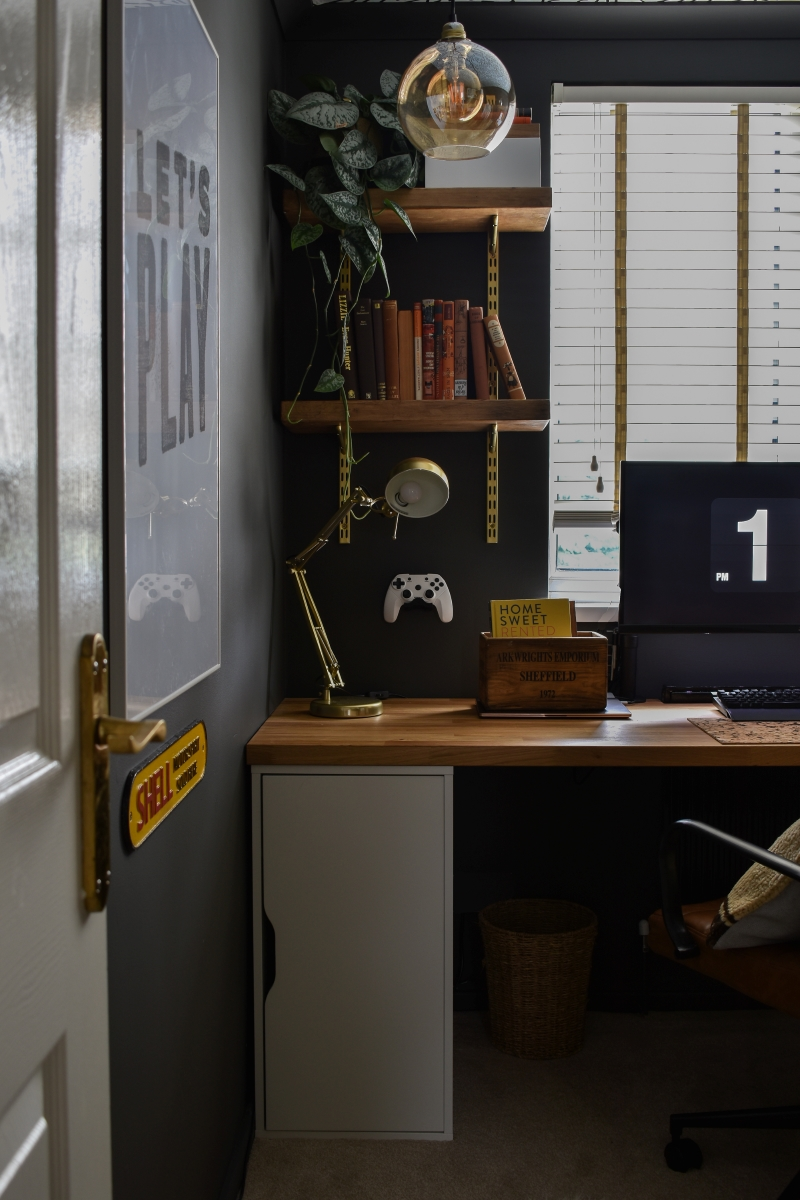 after shot cool man cave office with dark walls large wall art and bespoke wooden desk