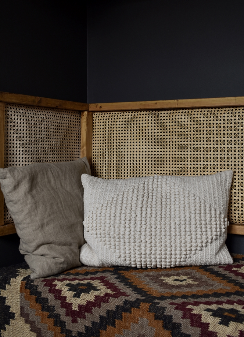 cool man cave office seating nook rattan back rest and pattern rug with neutral cushions