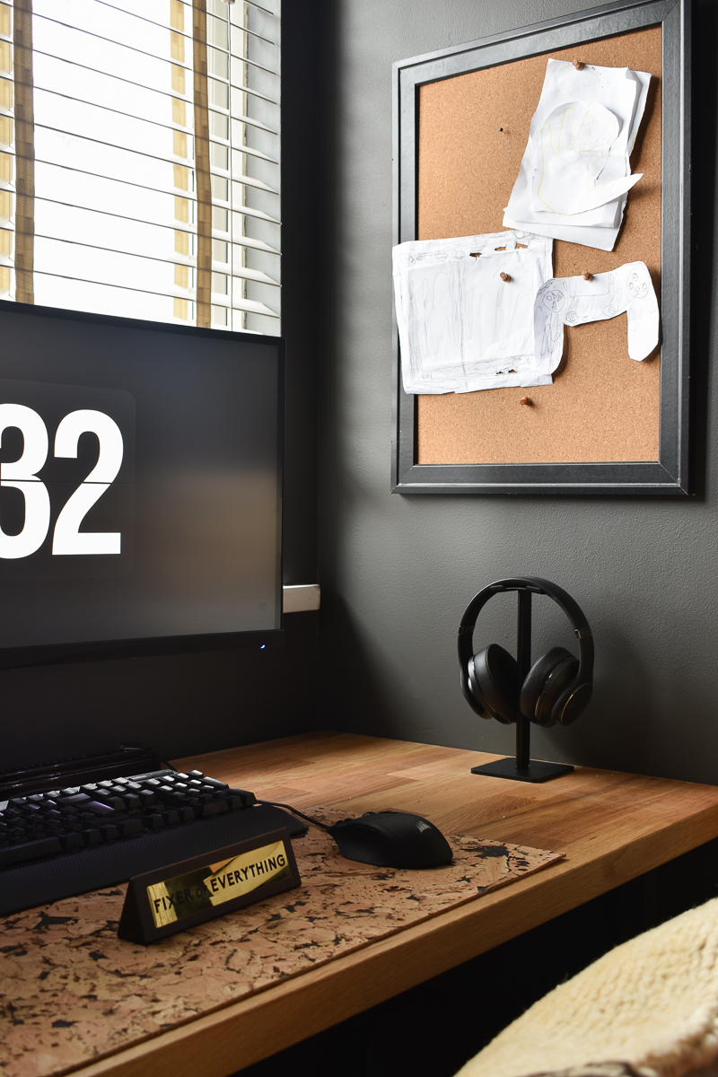 After shot cool man cave office with dark wall bespoke wooden desk and pin board