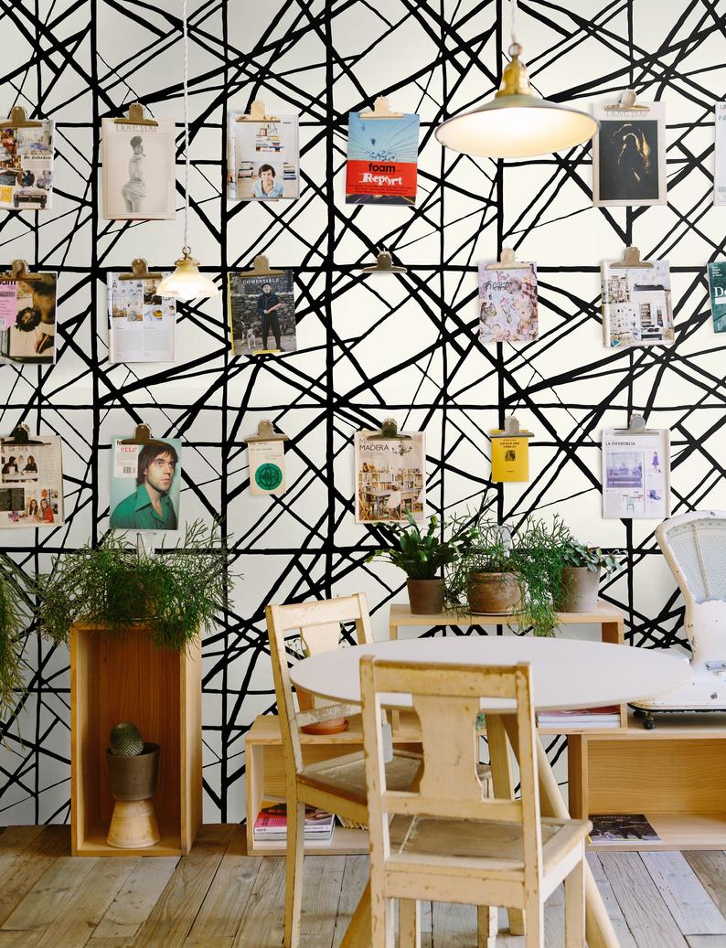 modern geometric monochrome self-adhesive wallpaper table and chairs and vintage posters