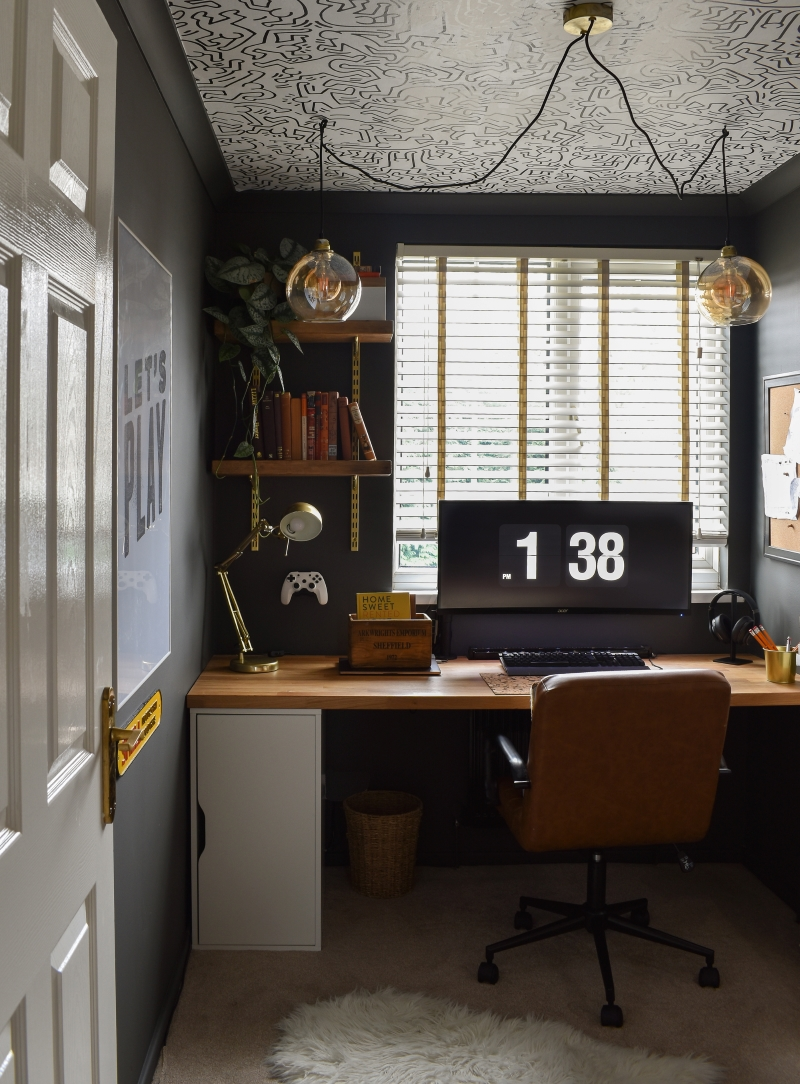 After shot cool man cave office dark wall colour bespoke wooden desk and monochrome self-adhesive wallpaper