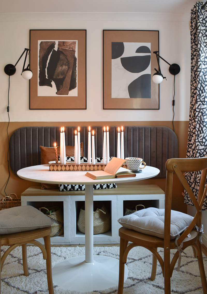Checkered candle stick holder on round table in dining room