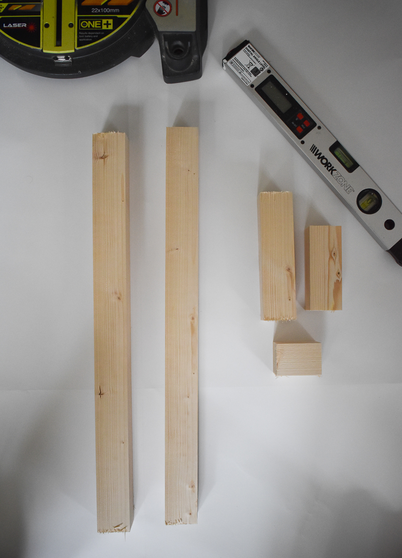 Image of equal wood length laid out on a white background