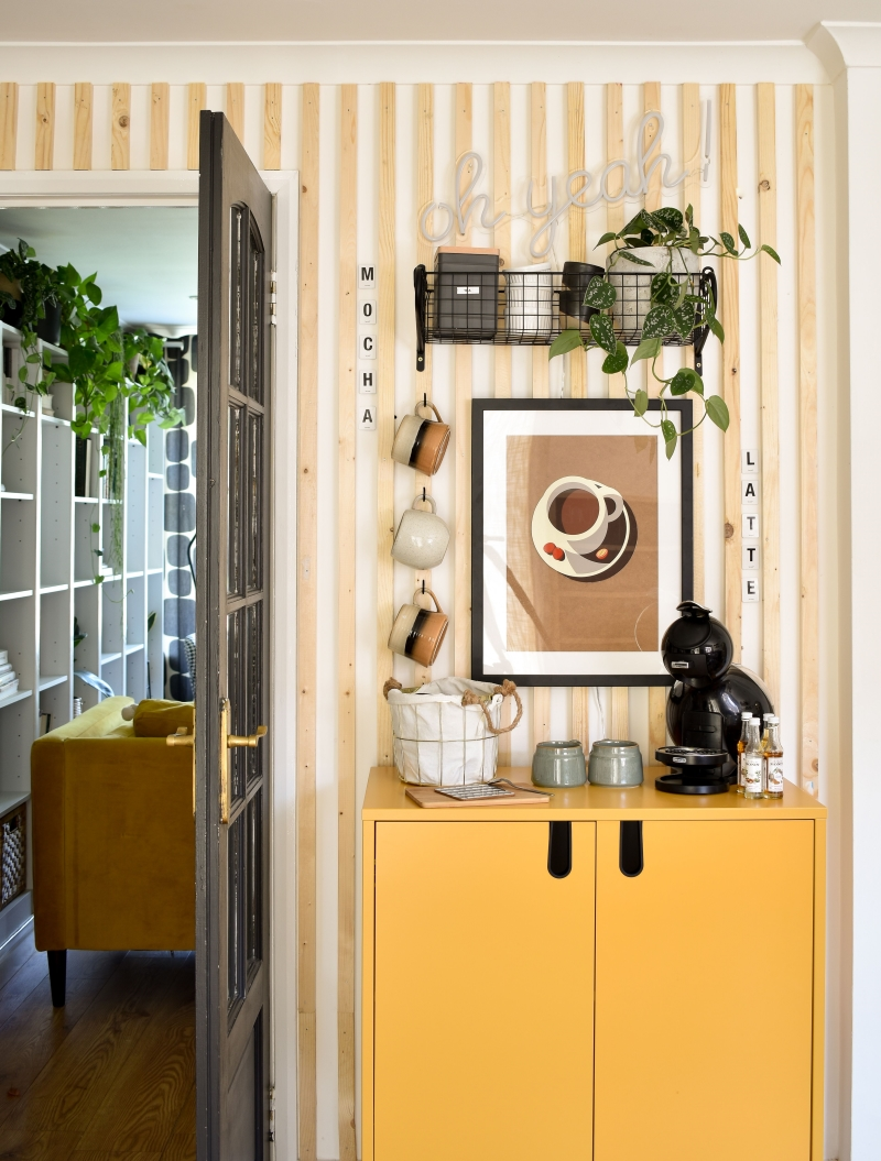 diy coffee station after shot with yellow cupboard cup hooks and wooden wall panelling