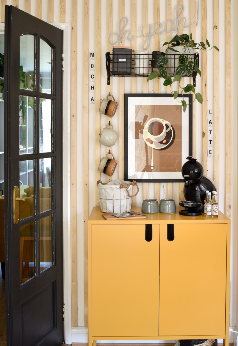 after shot diy coffee station with yellow cabinet stoneware cups on hooks neutral coffee cup wall art on wood panelling and basket shelf