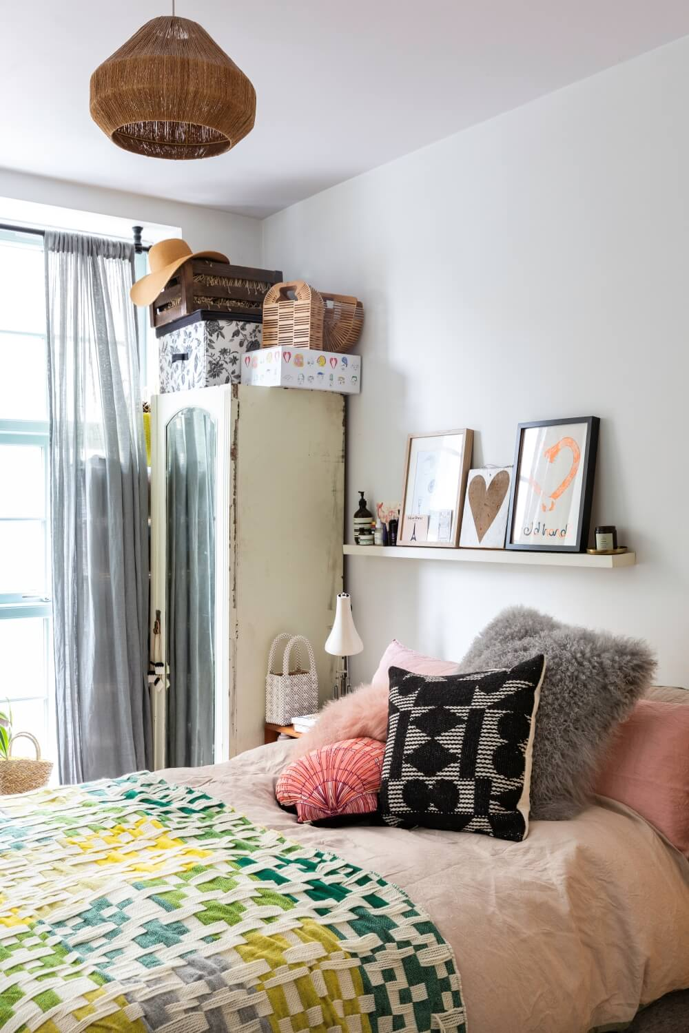 A small picture ledge serves as a nightstand above a bed.