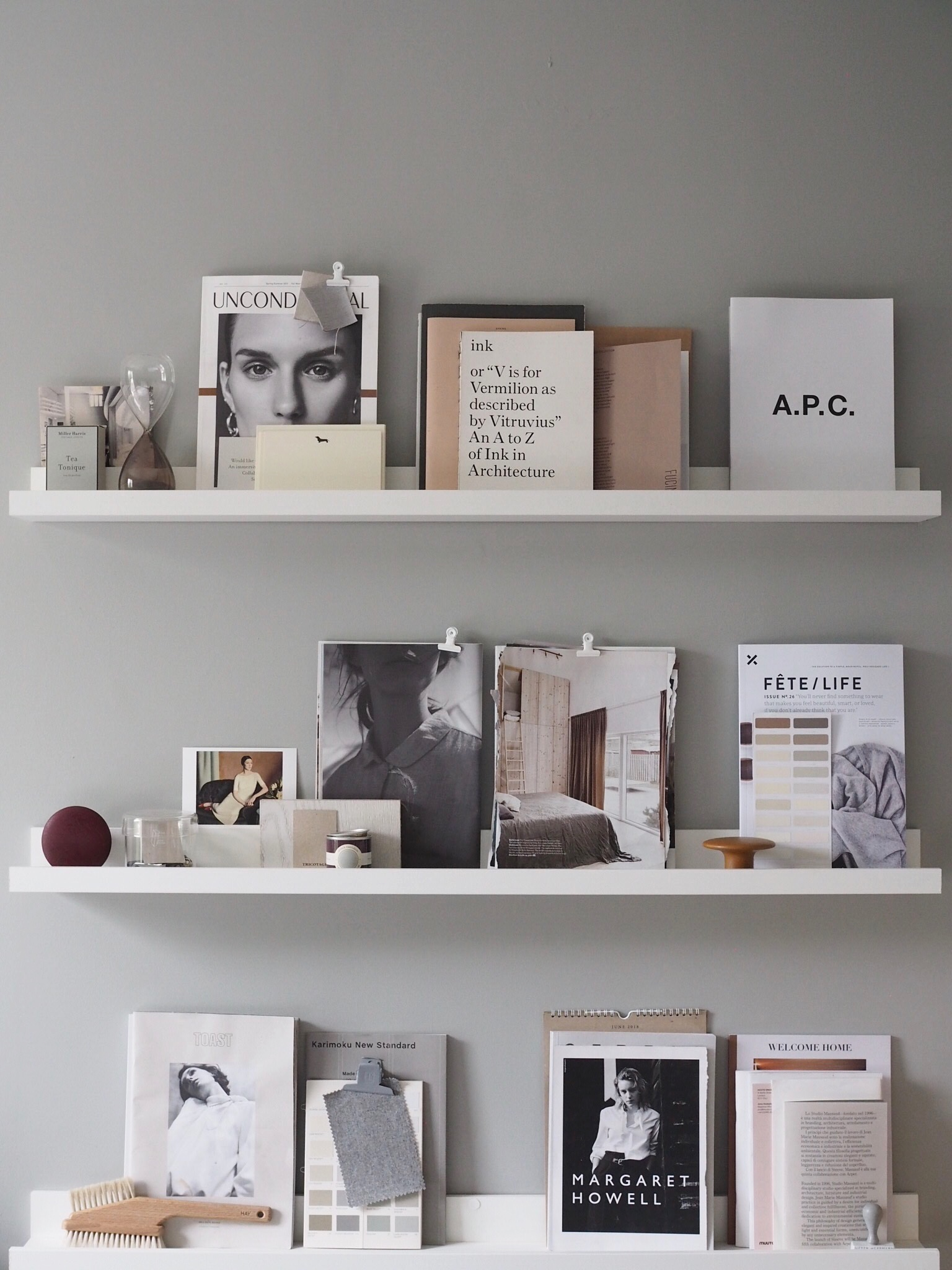 Picture ledges create a living mood board in a designer's work space.