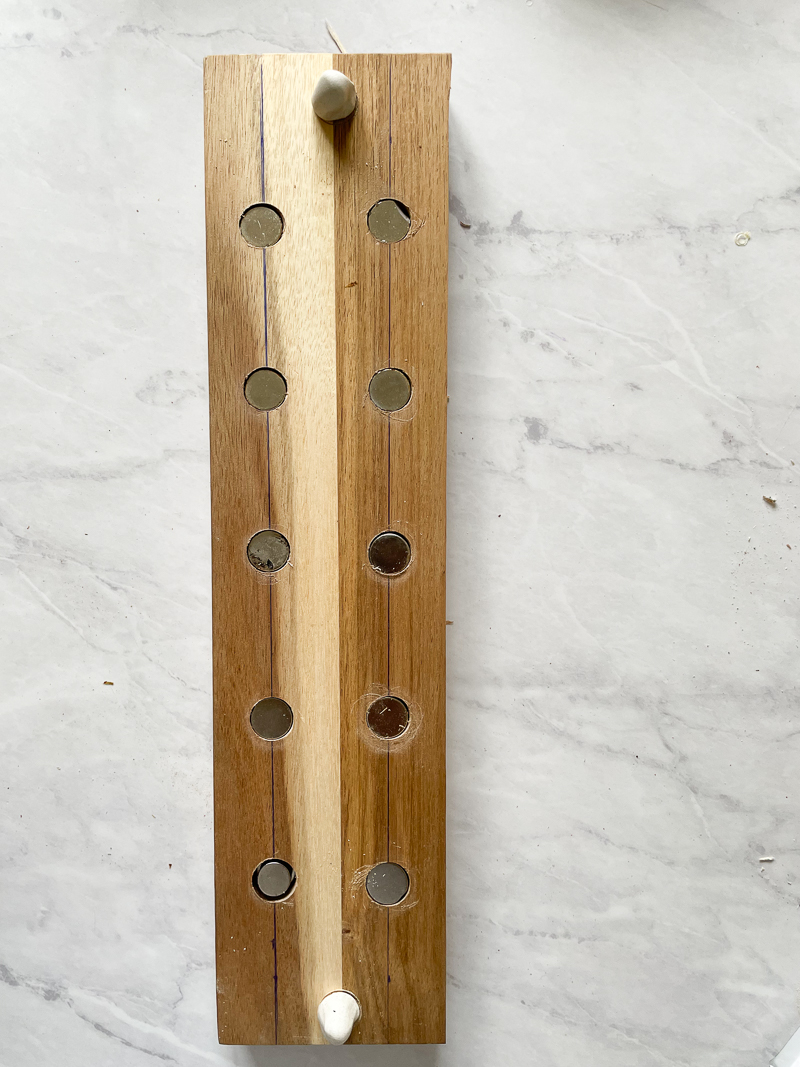 Wood with magnets in each hole, and sugru places on either end of wood.